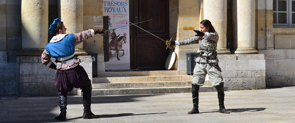 two fencers face off